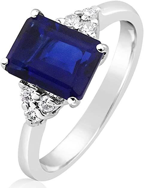 Mille Amori - Anello da donna in oro bianco 9 kt 375/1000, con diamanti 0,09 carati, zaffiro blu sintetico 1,60 carati, 8 x 6 cm, collezione Gems